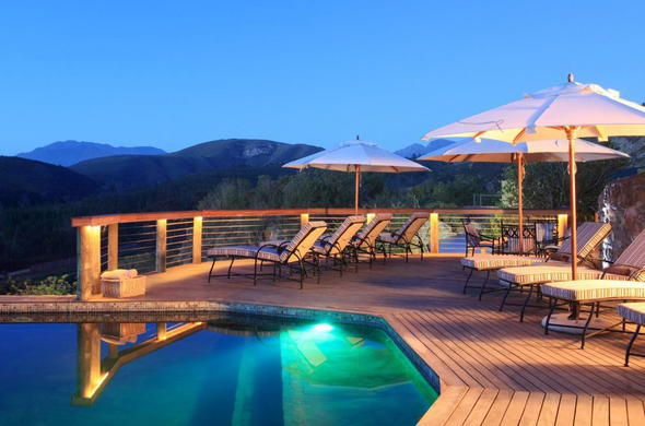 Enjoy scenic views of Botlierskop Game Reserve from the pool deck.
