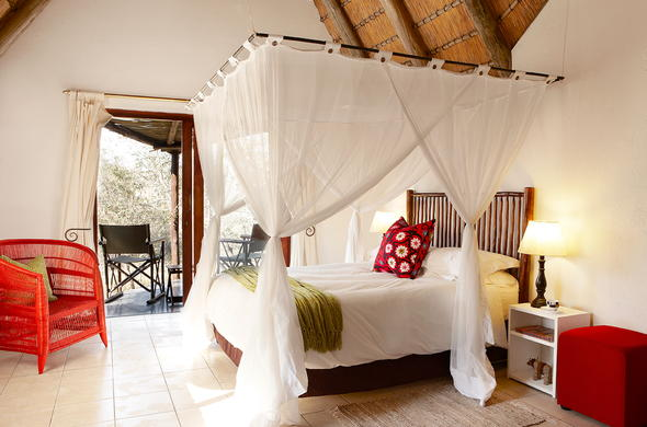 Spacious Cheetah Plains bedroom with private patio.