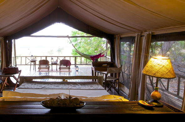 Enjoy tea on the patio of Katavi Wilderness Camp tented room