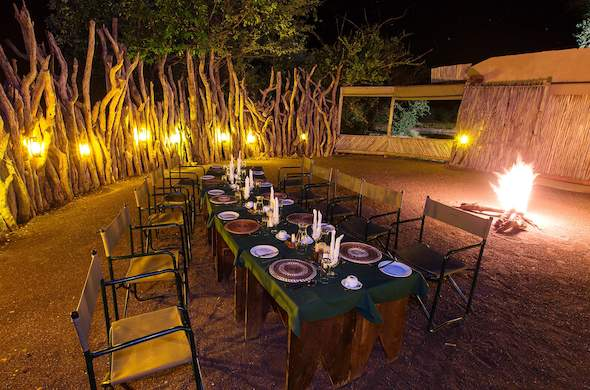 Outdoor dining around the traditional boma.
