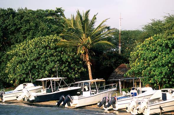 Motor boats on the shores of Rusinga Island Lodge.