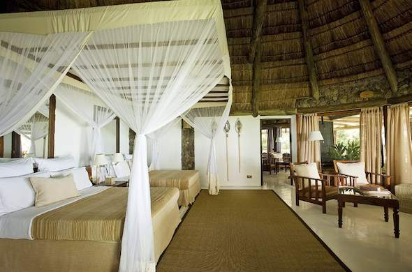 Spacious room with twin double beds at Rusinga Island Lodge.