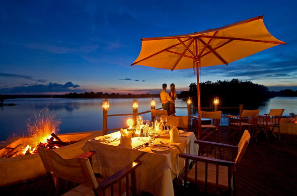 Romantic al fresco dinners with scenic Zambezi River views.