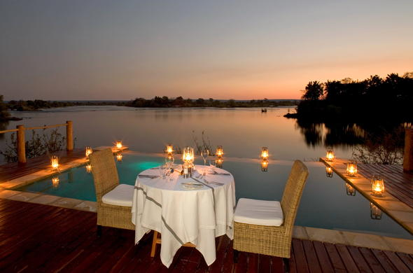 Private open-air dinners with views of Zambezi River.