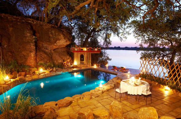 Private dining around the pool at Tongabezi Safari Lodge.