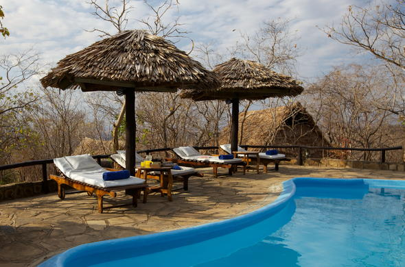 Spend an afternoon leisure around the swimming pool at Vuma Hills Tented Camp.